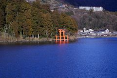 Mount Fuji with Lake Ashi from Hakone. Mount Fuji and a big red Torii (Gate to the Hakone Shrine) on the Ashinoko Lake Under the sky In the bright winter stock image
