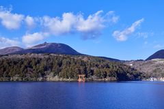 Mount Fuji with Lake Ashi from Hakone. Mount Fuji and a big red Torii (Gate to the Hakone Shrine) on the Ashinoko Lake Under the sky In the bright winter royalty free stock images