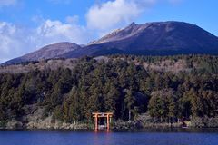 Mount Fuji with Lake Ashi from Hakone. Mount Fuji and a big red Torii (Gate to the Hakone Shrine) on the Ashinoko Lake Under the sky In the bright winter royalty free stock image