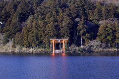 Mount Fuji with Lake Ashi from Hakone. Mount Fuji and a big red Torii (Gate to the Hakone Shrine) on the Ashinoko Lake Under the sky In the bright winter stock photo