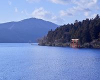 Mount Fuji with Lake Ashi from Hakone. Mount Fuji and a big red Torii (Gate to the Hakone Shrine) on the Ashinoko Lake Under the sky In the bright winter royalty free stock photography
