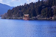 Mount Fuji with Lake Ashi from Hakone. Mount Fuji and a big red Torii (Gate to the Hakone Shrine) on the Ashinoko Lake Under the sky In the bright winter royalty free stock photos