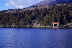 Mount Fuji with Lake Ashi from Hakone. Mount Fuji and a big red Torii (Gate to the Hakone Shrine) on the Ashinoko Lake Under the sky In the bright winter royalty free stock photo