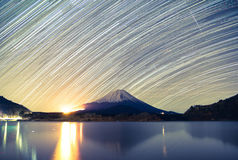 Mount Fuji, Lake Shojiko and star trails of winter stars Royalty Free Stock Images