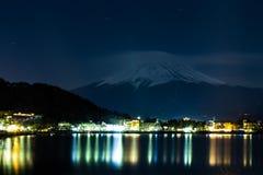 Mount Fuji and Lake Yamanaka at night. royalty free stock image
