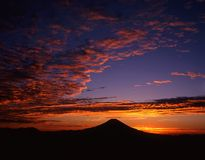 Mount Fuji LXXI. Dramatic and colorful sunrise over the silhouette of Mt. Fuji Stock Image