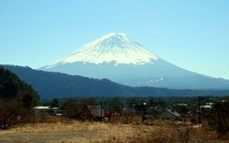 Mount Fuji and a nearby village, Japan Royalty Free Stock Image