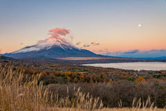 Mount Fuji with red cloud over the summit. Royalty Free Stock Photography