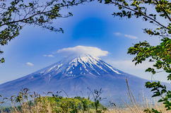 Mount Fuji. A relaxed and eye pleasing, scenic view of Mount Fuji Fuji san in Japanese. Snow cap on the top and covered with Lenticular cloud stock photography