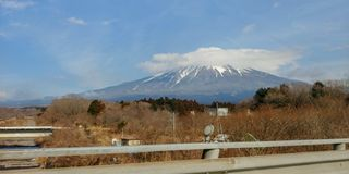 Mount Fuji on the road. Spectacular view of Mount Fuji while on the road around Mount Fuji region royalty free stock image