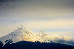 Mount Fuji's peak in cloundy sunset. Stock Photography
