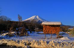 Mount Fuji snowy and blue sky from Oshino Village Japan royalty free stock photos