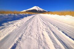 Mount Fuji on the snowy road of `Nashigahara` in Yamanashi Prefecture Japan royalty free stock images