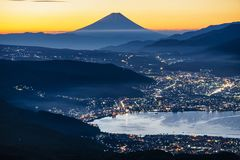 Mount Fuji and Suwa Lake at Sunrise, Nagano, Japan. Mount Fuji and Suwa Lake at Sunrise royalty free stock photo