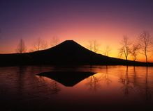 Mount Fuji V. Mount Fuji with reflections in an ice covered pond Royalty Free Stock Photography