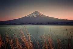 Japanese landscape at sunset. Mount Fuji viewed from Kawaguchi lake at sunset, Japan royalty free stock photo
