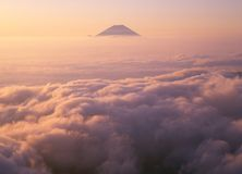Mount Fuji VII. Majestic Mount Fuji rising up through a sea of clouds Stock Images