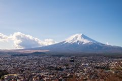 Mount Fuji and the village which is in front of the mountain. The Mount Fuji and the village which is in front of the mountain royalty free stock images