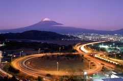 Mount Fuji XI. A freeway offramp in japan at night with Mount Fuji in the background Royalty Free Stock Photography