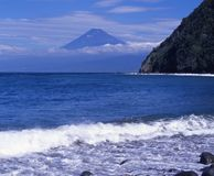 Mount Fuji XLVI. Waves breaking on the coast of Izu with Mt. Fuji in the background Stock Photography