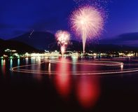 Mount Fuji XXV. A brilliant display of Fireworks and their reflections in the water with Mount Fuji in the background Stock Image