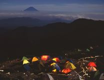 Mount Fuji XXVII. A campsite with colorful tents high in the Japan Alps at night with Mount Fuji in the background Stock Photos