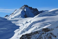 Mount Gletscherhorn and glacier with crevasses. Royalty Free Stock Image