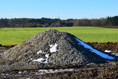 Mount gravel. A mountain of gravel on a construction site Royalty Free Stock Image