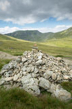 Mount Helvellyn, 950 metres high above Lake Ullswater. Pile of marker stones along a path on the way to the top of mount Helvellyn, 950 metres high above Lake royalty free stock image