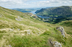 Mount Helvellyn, 950 metres high above Lake Ullswater. View of lake Ullswater and the village of Glenridding as seen from half way up mount Helvellyn, which Stock Photography
