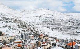 Mount Hermon och Druzebyn av Majdal hycklar Royaltyfria Bilder