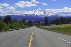 Mount Hood Oregon. Snow covered Mount Hood, a volcano in the Cascade Mountains in Oregon popular for hiking, climbing, snowboarding and skiing, despite the risks stock photography