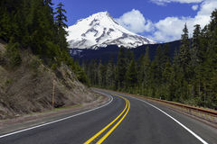 Mount Hood Oregon. Snow covered Mount Hood, a volcano in the Cascade Mountains in Oregon popular for hiking, climbing, snowboarding and skiing, despite the risks royalty free stock photos