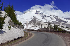 Mount Hood Oregon. Snow covered Mount Hood, a volcano in the Cascade Mountains in Oregon popular for hiking, climbing, snowboarding and skiing, despite the risks stock photo