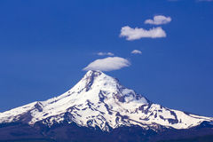 Mount hood with Smoke Stack Clouds Stock Image