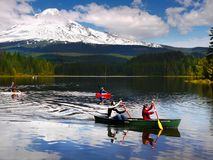 Mount Hood, Trillium Lake Summer Vacation, Oregon. Summer boating on beautiful Trillium Lake with Mt Hood  volcano in the background. Cascade Range, Oregon Stock Images
