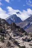 Mount Humphreys In The Clouds. Mount Humphreys pokes through the clouds above the buttermilks near Bishop California Stock Image