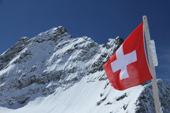 Mount Jungfrau behind the flag of Switzerland Stock Photography