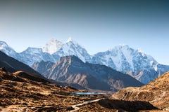 Mount Kangtega and Mount Thamserku at sunrise in Himalaya mountains, Nepal. View of Mount Kangtega and Mount Thamserku at sunrise in Himalaya mountains, Nepal stock images