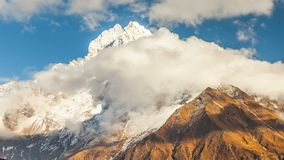 Mount Kangtega and moving clouds. Track to the base camp of Everest in the Himalayas. Sagarmatha National Park, Nepal.  stock video