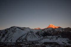 Mount Kazbeg and the Caucasus. Snow covered Caucasus landscape with dominant mount Kazbeg in Georgia, Europe near the town of Stepantsminda Royalty Free Stock Photo