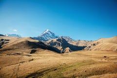 Mount Kazbek in the Caucasian mountains Stock Photos