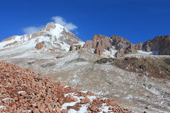 Mount Kazbek (Mkinvartsveri) in september (Georgia). Mount Kazbek (Mkinvartsveri) is a dormant stratovolcano and one of the major mountains of the Caucasus royalty free stock image