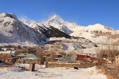 The Mount Kazbek and Stephantsminda town, Georgia Stock Photography