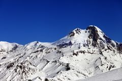 Mount Kazbek at sun winter day Royalty Free Stock Image
