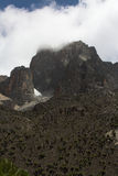 Mount Kenya 2 (cloudy). Peak of Mount Kenya disappearing in the clouds stock image