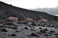 Mount Kilimanjaro base camp at the sunrise. The advanced mount Kilimanjaro base camp at the sunrise during the trekking to the summit Royalty Free Stock Photos