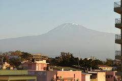 Mount Kilimanjaro from Moshi Town. An early morning shot of Mount Kilimanjaro from Moshi Town Stock Photography