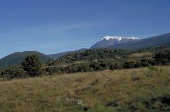 Mount Kilimanjaro, Tanzania. First view of Kibo Peak, Mt Kilimanjaro, on the second day of a trek to the summit stock images