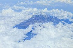 Mount Kilimanjaro. A view of Mount Kilimanjaro above the clouds, taken from the flightdeck of an airplane Royalty Free Stock Photos